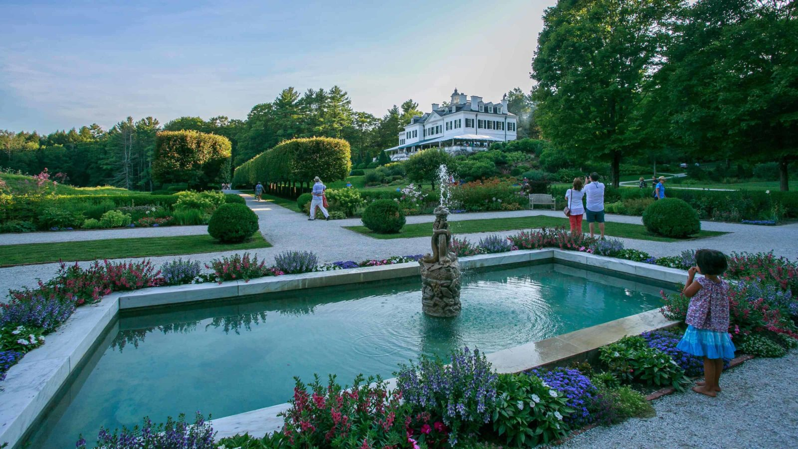 Summer visitors walk through the gardens at The Mount, writer and novelist Edith Wharton's home in Lenox, in the Berkshires.