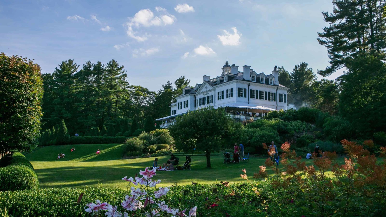 Families picnic on the lawn at the Mount, Edith Wharton's house in Lenox.