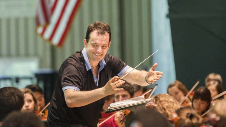 Andris Neslons rehearses with Tanglewood Music Center musicians at Tanglewood in Lenox. Photo by Marco Borggreve