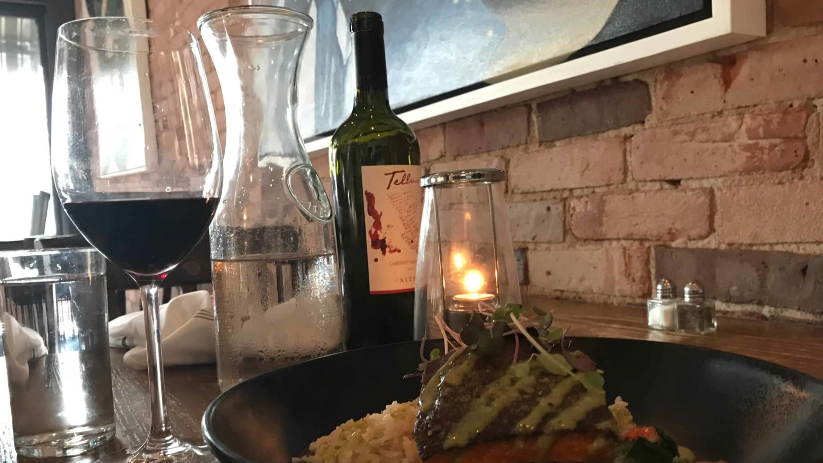 Light flickers on salmon and wine at Public Eat + Drink in North Adams.