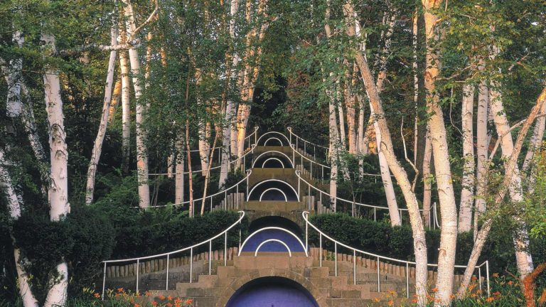 The famous blue stairs rise through young beech trees and ferns at sunset, at Naumkeag in Stockbridge.